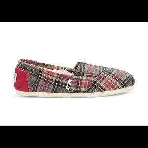 TOMS pink plaid shearling lined slip-ons.